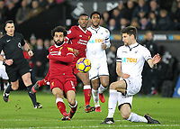 Mohamed Salah of Liverpool hits a shot at goal during the Premier League match between Swansea City and Liverpool at the Liberty Stadium, Swansea, Wales on 22 January 2018. Photo by Mark Hawkins / PRiME Media Images.