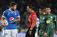 BOGOTA - COLOMBIA, 29-11-2017: Nicolas Gallo, árbitro, llama la atención a Matias De Los Santos (Izq) de Millonarios durante el encuentro entre Millonarios e La Equidad por los cuartos de final vuelta de la Liga Aguila II 2017 jugado en el estadio Nemesio Camacho El Campin de la ciudad de Bogota. / Nicolas Gallo, referee, calls the attention to Matias De Los Santos of Millonarios during second leg match between Millonarios and La Equidad for the quarterfinals of the Liga Aguila II 2017 played at the Nemesio Camacho El Campin Stadium in Bogota city. Photo: VizzorImage / Gabriel Aponte / Staff.