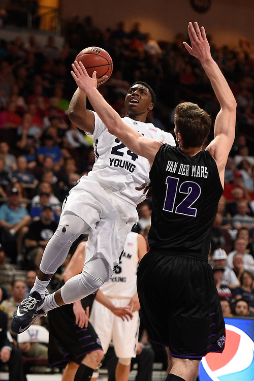 March 9, 2015; Las Vegas, NV, USA; Brigham Young Cougars guard Frank Bartley IV (24) shoots the basketball against Portland Pilots center Thomas van der Mars (12) during the first half of the WCC Basketball Championships at Orleans Arena.