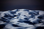 Ice dunes on Petermann Glacier, in remote northwestern Greenland, on Nares Strait, near Canada's Ellesmere Island.  Photographed during a 2009 Greenpeace expedition to investigate the effects of climate change in the Arctic. In 2010 and 2012 Petermann calved ice islands totalling 400 square kilometres.