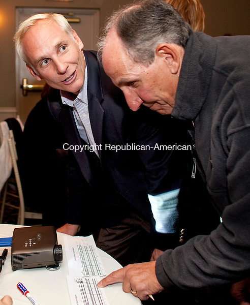 SOUTHINGTON, CT-02 November 2010-110210BF06--  Democrat John Barry,left, candidate for the 16th Senate District, goes over poll number with Bob Galati. Barry lost the race to Republican Joe Markley. The 16th District serves Southington, Cheshire, Wolcott and Waterbury.<br /> Bob Falcetti Republican-American