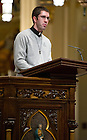 Nov. 2, 2012; Holy Cross seminarian Pat Riedy, C.S.C. speaks during the nineteenth annual Notre Dame Folk Choir concert for the Holy Cross Missions in the Basilica of the Sacred Heart. Photo by Barbara Johnston/University of Notre Dame