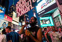 New York, NY - 11 July 2014 Man with a Jesus Saves sign in Times Square ©Stacy Walsh Rosenstock/Alamy