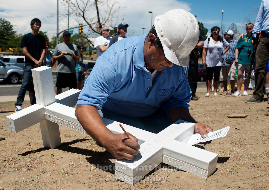 Greg Zanis (cq), from Aurora, IL, puts the finishing touches on crosses for a shrine for the victims of the shooting at an Aurora Century 16 theater where James Holmes (cq), 24, killed 12 people and wounded many more in Aurora, Colorado, Sunday, July 22, 2012. The shootings occurred during the midnight premiere of the new Dark Knight Batman movie...Photo by MATT NAGER