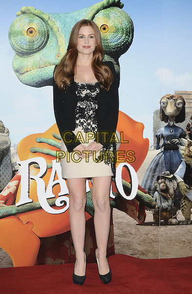 ISLA FISHER.Photocall for new animated film 'Rango' at Claridge's Hotel, London., England, UK, 22nd February 2011..full length beige cream dress shoes heels christian louboutin black jacket suit blazer lace .CAP/CAN.©Can Nguyen/Capital Pictures.