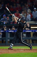 Brendan McKay (38) of the Louisville Cardinals follows through on his swing against the Notre Dame Fighting Irish in Game Eight of the 2017 ACC Baseball Championship at Louisville Slugger Field on May 25, 2017 in Louisville, Kentucky. The Cardinals defeated the Fighting Irish 10-3. (Brian Westerholt/Four Seam Images)