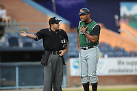Augusta GreenJackets Manager Lipso Nava #17 makes a point with Home Plate Umpire Ramon Hernandez during a game against the Asheville Tourists at McCormick Field in Asheville,  North Carolina;  June 1, 2011.  The GreenJackets won the game 13-6.  Photo By Tony Farlow/Four Seam Images
