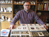 BNPS.co.uk (01202 558833)<br /> Pic: DavidMarks/BNPS<br /> <br /> David Marks with his collection.<br /> <br /> These are the witty postcards Brits would send to each other to keep morale up while they were being showered by German bombs during the Zeppelin raids of the First World War.<br /> <br /> First World War aviation expert David Marks has collected 200 propaganda postcards and used them to tell the story of the Zeppelin raids in his new book.<br /> <br /> The Kaiser and his military advisers hoped the Zeppelins would strike terror into the hearts of the British people, but instead the defiant British created comic postcards to mark their visits.<br /> <br /> Crowds of people would visit the crash sites to collect souvenirs from the wreckage of shot-down Zeppelins, while Zeppelin-slaying pilots became overnight heroes.<br /> <br /> The satirical postcards poked fun at the Kaiser and promoted the image of a stoic British people not intimidated by the aerial bombardment.