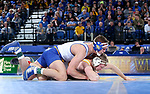 BROOKINGS, SD - JANUARY 18: David Kocer from South Dakota State University has control of Kyle Pope from Wyoming during their 174 pound match Thursday night at Frost Arena in Brookings. (Photo by Dave Eggen/Inertia)