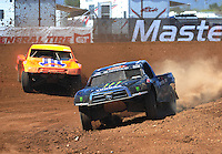 Apr 16, 2011; Surprise, AZ USA; LOORRS driver Rick Huseman (36) leads Adrian Cenni (11) during round 3 at Speedworld Off Road Park. Mandatory Credit: Mark J. Rebilas-.