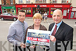 This weeks buyKerry Winner Katherine Condon, Tralee choose Garveys Supervalu, Rock Street, Tralee as her buyKerry Shop also in photo are Kevin O'Connor Manager Garveys (on Left) and Brendan Kennelly, Kerry's Eye.
