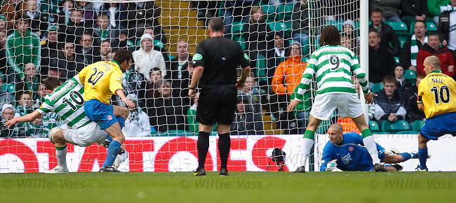jan Vennegoor of Hesselink gets in ahead of Martin Canning to score for Celtic