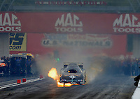 Aug. 31, 2012; Claremont, IN, USA: NHRA funny car driver Jon Capps has a fire during qualifying for the US Nationals at Lucas Oil Raceway. Mandatory Credit: Mark J. Rebilas-