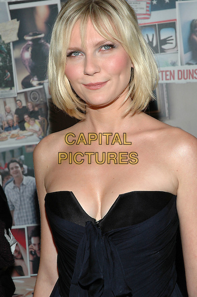 "KIRSTEN DUNST.Premiere of ""Elizabethtown"", at the Loews Lincoln Square Theater in Manhattan, New York, New York ..October 10th, 2005.Photo Credit: Patti Ouderkirk/AdMedia/Capital Pictures.Ref: PO/ADM/CAP.half length black strapless cleavage.www.capitalpictures.com.sales@capitalpictures.com.© Capital Pictures."