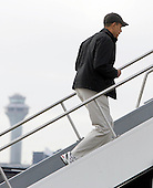 Chicago, IL - December 20, 2008 -- United States President-elect  Barack Obama jogs up stairs as he boards a plane for a 12-day vacation in Hawaii at Chicago's O'Hare International airport Saturday December 20, 2008, in Chicago, Illinois. .Credit: Frank Polich - Pool via CNP