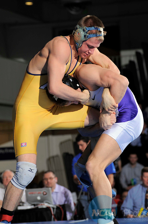 10 MAR 2012: Kyle Mccrite from Grand Canyon University (white/purple) wrestles Cody Lensing from Augustana College (gold) during the Division II Men's Wrestling Championship held at Massari Arena in Pueblo, CO. Mccrite won the 125 pound title. Jack Dempsey/NCAA Photos