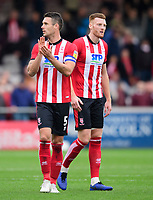 Lincoln City's Jason Shackell, left, and Lincoln City's Cian Bolger<br /> <br /> Photographer Chris Vaughan/CameraSport<br /> <br /> The EFL Sky Bet League One - Lincoln City v Sunderland - Saturday 5th October 2019 - Sincil Bank - Lincoln<br /> <br /> World Copyright © 2019 CameraSport. All rights reserved. 43 Linden Ave. Countesthorpe. Leicester. England. LE8 5PG - Tel: +44 (0) 116 277 4147 - admin@camerasport.com - www.camerasport.com