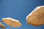 Sunshades against deep blue Mediterranean sky