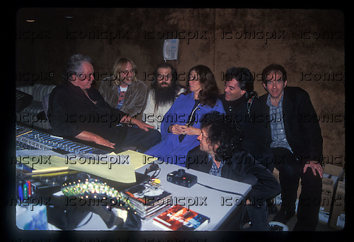 "JOHNNY CASH - Johnny Cash, Tom Petty, Rick Rubin, June Carter Cash, Marty Stuart, Mike Campbell and Benmont Tench during the recording sessions for Johnny Cash's ""Unchained"" CD Produced by Rick Rubin.   Photographed at Sound City Studios in Van Nuys, CA USA - January 26, 1996.  Photo © Kevin Estrada / Iconicpix"
