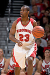 MADISON, WI - NOVEMBER 3: Guard Kammron Taylor #23 of the Wisconsin Badgers handles the ball against the University of Wisconsin-Stout Blue Devils at the Kohl Center on September 3, 2006 in Madison, Wisconsin. The Badgers beat the Blue Devils 82-33. Photo by David Stluka
