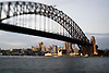 Sydney Harbour Bridge with Luna Park lit in the background, Australia
