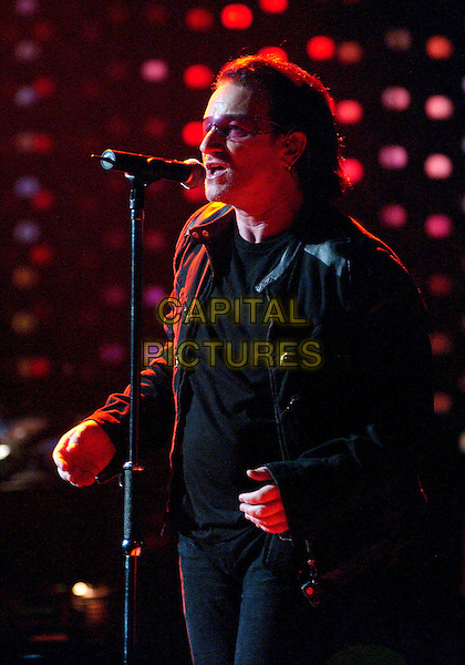 "U2 - BONO (PAUL HEWSON).Tour stop on their ""Vertigo Tour 2005"" at the Mellon Arena, Pittsburgh, PA, USA.  .October 22nd, 2005.Photo: Jason Nelson/AdMedia/Capital Pictures.Ref: JN/ADM .half length stage concert gig live performance music .www.capitalpictures.com.sales@capitalpictures.com.© Capital Pictures."