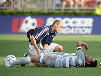 FC Dallas forward Carlos Ruiz (20) gets attention from the team trainer after being fouled during an MLS regular season match against the Houston Dynamo at Robertson Stadium in Houston, TX on August 19, 2007.