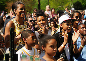 First Lady Michelle Obama, Jada Pinkett Smith, her son Jaden Smith, and Michelle's daughter Malia (L to R) watch Jada's daughter Willow Smith perform during the White House Easter Egg Roll on the South Lawn of the White House in Washington, DC, on Monday, April 25, 2011. .Credit: Roger L. Wollenberg / Pool via CNP