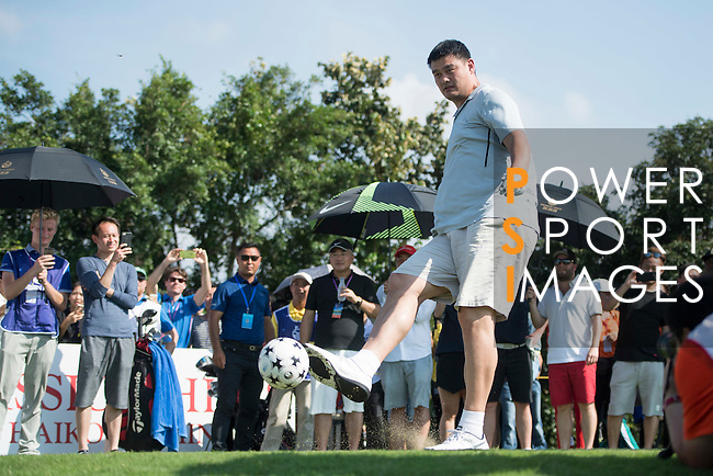 Yao Ming kicks a football at the 14th hole during the World Celebrity Pro-Am 2016 Mission Hills China Golf Tournament on 22 October 2016, in Haikou, China. Photo by Weixiang Lim / Power Sport Images