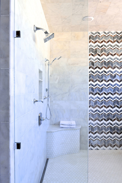 This custom shower features Marilyn, a handmade mosaic shown in Tourmaline, Absolute White, Lavastone and Labradorite jewel glass is part of the Ann Sacks Beau Monde collection by Sara Baldwin and is sold exclusively at www.annsacks.com<br />