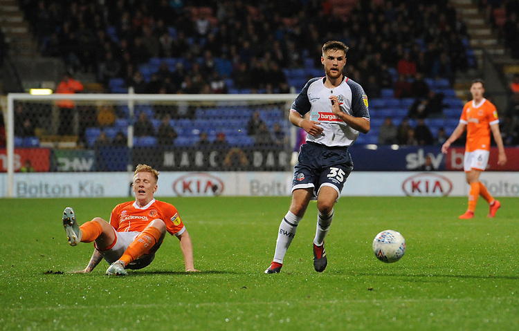 Blackpool's Callum Guy slips as he shoots from range<br /> <br /> Photographer Kevin Barnes/CameraSport<br /> <br /> The EFL Sky Bet League One - Bolton Wanderers v Blackpool - Monday 7th October 2019 - University of Bolton Stadium - Bolton<br /> <br /> World Copyright © 2019 CameraSport. All rights reserved. 43 Linden Ave. Countesthorpe. Leicester. England. LE8 5PG - Tel: +44 (0) 116 277 4147 - admin@camerasport.com - www.camerasport.com