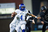 NWA Democrat-Gazette/CHARLIE KAIJO North Little Rock quarterback Kareame Cotton (4) carries the ball, Friday, November 29, 2019 during the Class 7A semifinal at Bentonville High School in Bentonville.