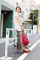 July 28, 2012, Tokyo, Japan - Midori Sugimori, 34, Decoration Designer. Today's fashion point - shoes and stole. Favorite brand - goa. Bought clothing from - goa store. Favorite fashion style - long skirts. Favorite place - shopping around the Shibuya to Omotesando area and eating delicious cake in Daikanyama. (Photo by Christopher Jue/Nippon News)