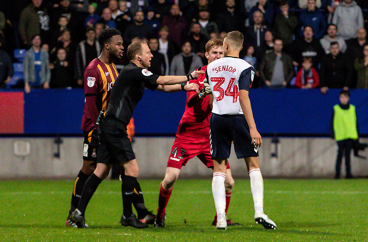 Bolton Wanderers' Adam Senior (right) reacts to a comment from Bradford City's Jermaine Anderson <br /> <br /> Photographer Andrew Kearns/CameraSport<br /> <br /> EFL Leasing.com Trophy - Northern Section - Group F - Bolton Wanderers v Bradford City -  Tuesday 3rd September 2019 - University of Bolton Stadium - Bolton<br />  <br /> World Copyright © 2018 CameraSport. All rights reserved. 43 Linden Ave. Countesthorpe. Leicester. England. LE8 5PG - Tel: +44 (0) 116 277 4147 - admin@camerasport.com - www.camerasport.com