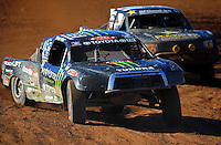 Apr 16, 2011; Surprise, AZ USA; LOORRS driver Marty Hart (15) leads Rob MacCachren (1) during round 3 at Speedworld Off Road Park. Mandatory Credit: Mark J. Rebilas-