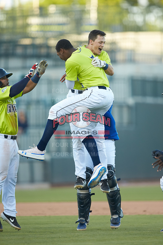 Brian Sharp (7) of the Columbia Fireflies celebrates with teammate Shervyen Newton (3) after his walk-off hit in the bottom of the 7th inning against the Rome Braves at Segra Park on May 13, 2019 in Columbia, South Carolina. The Fireflies walked-off the Braves 2-1 in game one of a doubleheader. (Brian Westerholt/Four Seam Images)