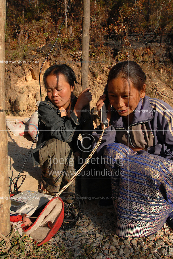 "S?dostasien Asien Indochina Laos .deutsche laotische Firma Sunlabob installiert kleine Wasserkraftwerke Photovoltaic und Stromnetz zur autarken Energieversorgung im Hmong Dorf Nam Kha , Frauen am Dorf Telefon  -  Energie Solar Wasserkraft Wasserenergie Strom Strovmersorgung renewables erneuerbare regenerative off-grid Insell?sung l?ndliche Entwicklung xagndaz | .Southeast Asia Laos .lao german company Sunlabob install minihydro power photovoltaic and village electricity grid in Hmong village Nam Kha , women at village telephone exchange -  energy renewable off-grid .| [ copyright (c) Joerg Boethling / agenda , Veroeffentlichung nur gegen Honorar und Belegexemplar an / publication only with royalties and copy to:  agenda PG   Rothestr. 66   Germany D-22765 Hamburg   ph. ++49 40 391 907 14   e-mail: boethling@agenda-fototext.de   www.agenda-fototext.de   Bank: Hamburger Sparkasse  BLZ 200 505 50  Kto. 1281 120 178   IBAN: DE96 2005 0550 1281 1201 78   BIC: ""HASPDEHH"" ,  WEITERE MOTIVE ZU DIESEM THEMA SIND VORHANDEN!! MORE PICTURES ON THIS SUBJECT AVAILABLE!!  ] [#0,26,121#]"