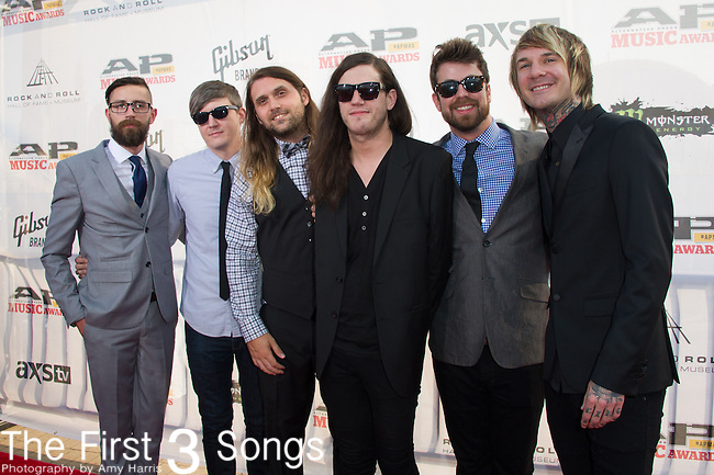 Craig Owens, Pat McManaman, Matt Goddard, Bradley Bell, Derrick Frost, and Thomas Erak of Chiodos attend the 2014 AP Music Awards at the Rock And Roll Hall Of Fame and Museum at North Coast Harbor in Cleveland, Ohio.