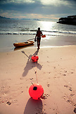 BRAZIL, Rio de Janiero, a man preparing to bring his kayak into the water at Copacabana Beach
