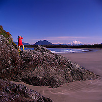 Hiker hiking on Chesterman Beach near Pacific Rim National Park Reserve, on West Coast of Vancouver Island, BC, British Columbia, Canada (Model Released)