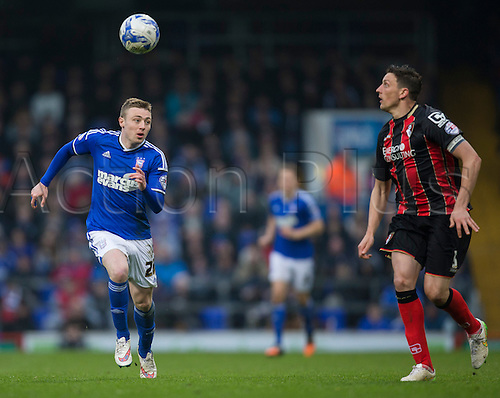 03.04.2015.  Ipswich, England. Skybet Championship. Ipswich Town versus AFC Bournemouth. Ipswich Town's Freddie Sears (left) and Bournemouth's Tommy Elphick chase down the loose ball.