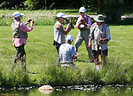 Staff and guides watch as breast cancer survivor Michele Kimzey, of Placerville, kisses her catch during a Casting for Recovery retreat in Gardnerville, Nev., on Friday, June 30, 2017.  <br /> Photo by Cathleen Allison/Nevada Photo Source