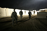 U.S. soldiers from Company C, 1st Battalion, 12th Infantry Regiment, head out on a pre-dawn patrol in Zhari district, in Kandahar province, Afghanistan. President Obama is expected to announce up to 35,000 more troops for Afghanistan in coming weeks. Most of them will likely be deployed to Kandahar and other southern provinces in an effort to stem the worsening Taliban insurgency. Nov. 24, 2009. DREW BROWN/STARS AND STRIPES