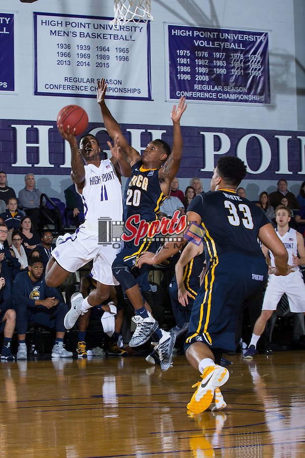Haiishen McIntyre (11) of the High Point Panthers drives to the basket past Diante Baldwin (20) of the UNCG Spartans during first half action at Millis Athletic Center on December 9, 2015 in High Point, North Carolina.  The Panthers defeated the Spartans 90-72.   (Brian Westerholt/Sports On Film)