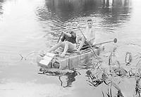 Photo from the NIOD's Huizinga collection. Two boys play after the liberation with a self-built raft of food cans and wood.