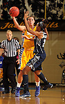BROOKINGS, SD - NOVEMBER 15:  Megan Stuart #3 from South Dakota State University passes around Faith Woodward #24 from Georgetown in the first half of their game Friday night at Frost Arena. (Photo by Dave Eggen/Inertia)