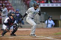 Clinton LumberKings designated hitter Dimas Ojeda (14) swings at a pitch against the Cedar Rapids Kernels at Veterans Memorial Stadium on April 13, 2018 in Cedar Rapids, Iowa. Clinton won 2-0.  (Dennis Hubbard/Four Seam Images)