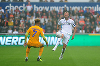 Preston North End's Callum Robinson vies for possession with Swansea City's Mike van der Hoorn during the Sky Bet Championship match between Swansea City and Preston North End at the Liberty Stadium, Swansea, Wales, UK. Saturday 11 August 11 2018