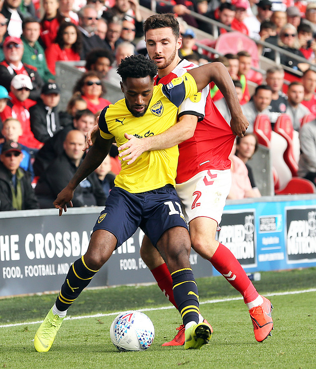 Oxford United's Tariqe Fosu shields the ball from Fleetwood Town's Lewis Coyle<br /> <br /> Photographer Rich Linley/CameraSport<br /> <br /> The EFL Sky Bet League One - Fleetwood Town v Oxford United - Saturday 7th September 2019 - Highbury Stadium - Fleetwood<br /> <br /> World Copyright © 2019 CameraSport. All rights reserved. 43 Linden Ave. Countesthorpe. Leicester. England. LE8 5PG - Tel: +44 (0) 116 277 4147 - admin@camerasport.com - www.camerasport.com