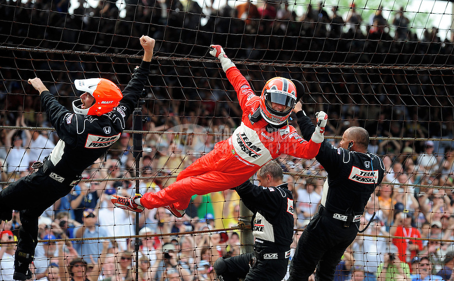 May 24, 2009; Indianapolis, IN, USA; IRL driver Helio Castroneves climbs the fence with his crew after winning the 93rd running of the Indianapolis 500 at Indianapolis Motor Speedway.  Mandatory Credit: Mark J. Rebilas-